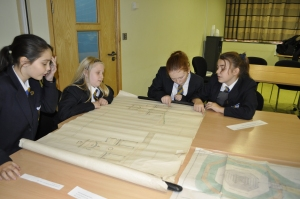Pupils compare the plans for the proposed War Memorial with the one that was actually built.