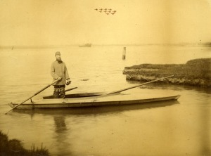 Albert Beckett, standing on a punt in Breydon Water. Image courtesy of Picture Norfolk