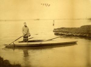 Albert Beckett, standing on a punt in Breydon Water. Image courtesy of Picture Norfolk