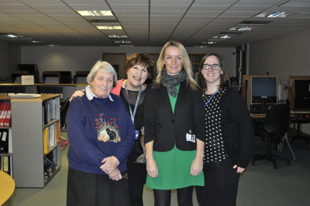 Some of the Searchroom Team with a regular researcher.
